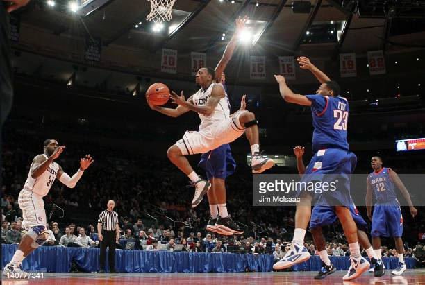 Ryan Boatright of the Connecticut Huskies goes to the hoop for a basket against Cleveland Melvin of the DePaul Blue Demons during their first round...