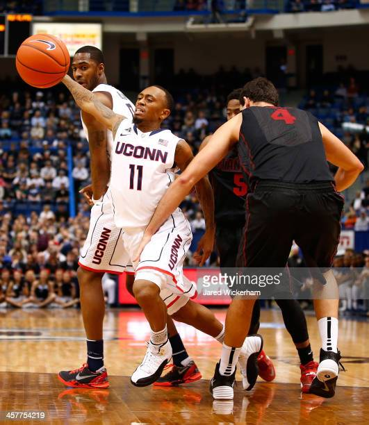 Ryan Boatright of the Connecticut Huskies is fouled by Stefan Nastic of the Stanford Cardinal in the first half during the game at XL Center on...
