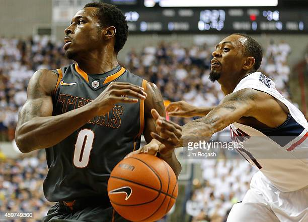 Ryan Boatright of the Connecticut Huskies strips the ball from Kendal Yancy of the Texas Longhorns in the first half at Harry A Gampel Pavilion on...