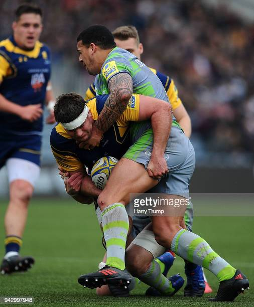 Ryan Bower of Worcester Warriors is tackled by Josh Matavesi of Newcastle Falcons during the Aviva Premiership match between Worcester Warriors and...