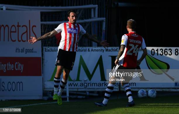 Ryan Bowman of Exeter City celebrates after scoring his side's third goal during the Sky Bet League Two Play Off Semi-final 2nd Leg match between...