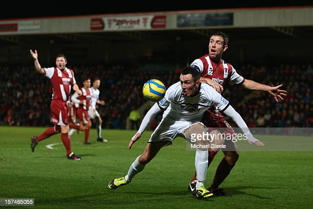 Ryan Bowman of Hereford United shields the ball as Billy Jones of Cheltenham Town challenges during the FA Cup with Budweiser Second Round match...