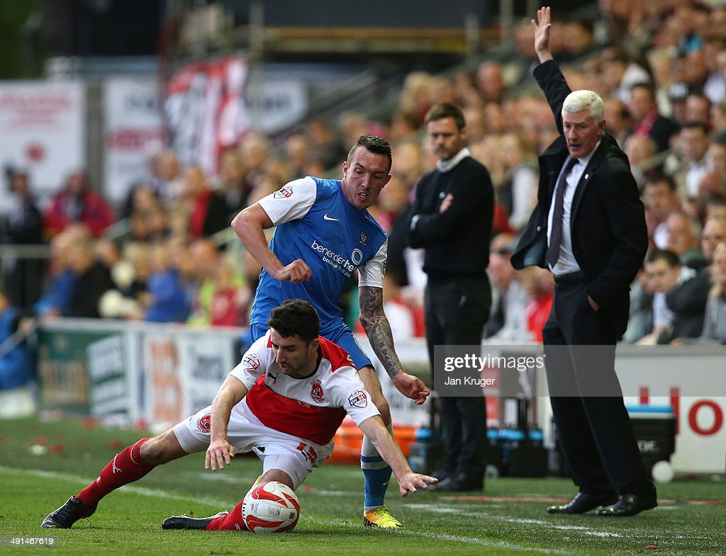Ryan Bowman of York City competes for the ball with Conor McLaughlin of Fleetwood Town during the Sky Bet League Two play off Semi Final second leg match between Fleetwood Town and York City at Highbury Stadium on May 16, 2014 in Fleetwood, England.