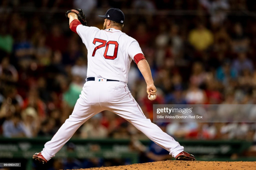 Ryan Brasier #70 of the Boston Red Sox pitches during the ninth inning of a game against the Texas Rangers on July 9, 2018 at Fenway Park in Boston, Massachusetts.