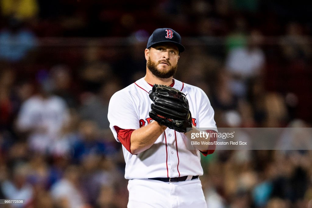 Ryan Brasier #70 of the Boston Red Sox reacts after recording the final out of a game against the Texas Rangers on July 10, 2018 at Fenway Park in Boston, Massachusetts.