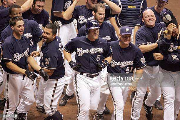 Ryan Braun and Brian Shouse of the Milwaukee Brewers celebrate with teammate Geoff Jenkins after Jenkins hit a two-run, walk-off home run in the...