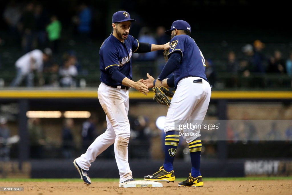 Ryan Braun #8 and Jonathan Villar #5 of the Milwaukee Brewers celebrate after beating the St. Louis Cardinals 7-5 at Miller Park on April 20, 2017 in Milwaukee, Wisconsin.