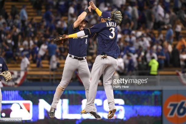 Ryan Braun and Orlando Arcia of the Milwaukee Brewers celebrate after they defeated the Los Angeles Dodgers 40 in Game Three of the National League...