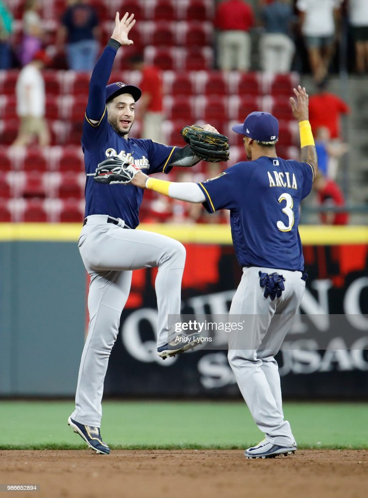 Ryan Braun #8 and Orlando Arcia #3 of the Milwaukee Brewers celebrate after the last out of the 6-4 win against the Cincinnati Reds at Great American Ball Park on June 28, 2018 in Cincinnati, Ohio.