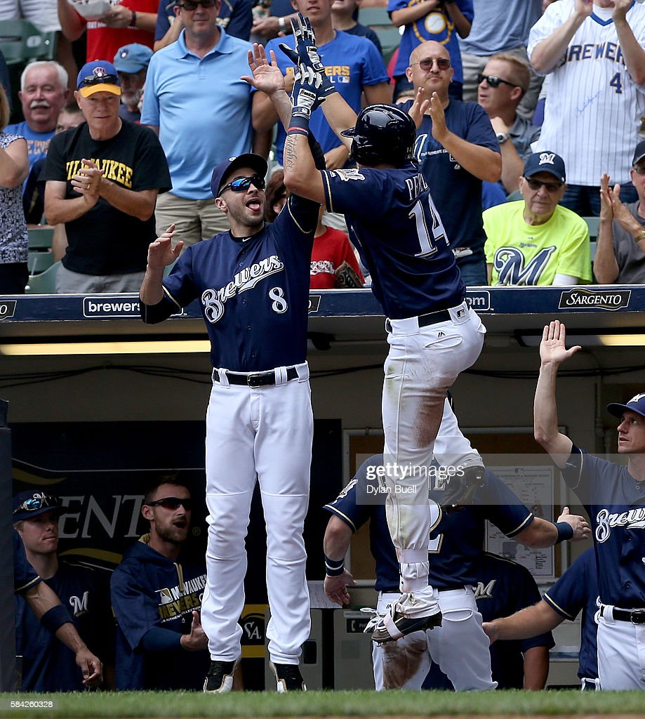Ryan Braun #8 congratulates Hernan Perez #14 of the Milwaukee Brewers after Perez hit a home run in the third inning against the Arizona Diamondbacks at Miller Park on July 28, 2016 in Milwaukee, Wisconsin.