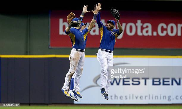 Ryan Braun Hernan Perez and Domingo Santana of the Milwaukee Brewers celebrate after beating the Cincinnati Reds 54 at Miller Park on September 23...