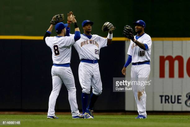Ryan Braun Keon Broxton and Domingo Santana of the Milwaukee Brewers celebrate after beating the Philadelphia Phillies 96 at Miller Park on July 14...