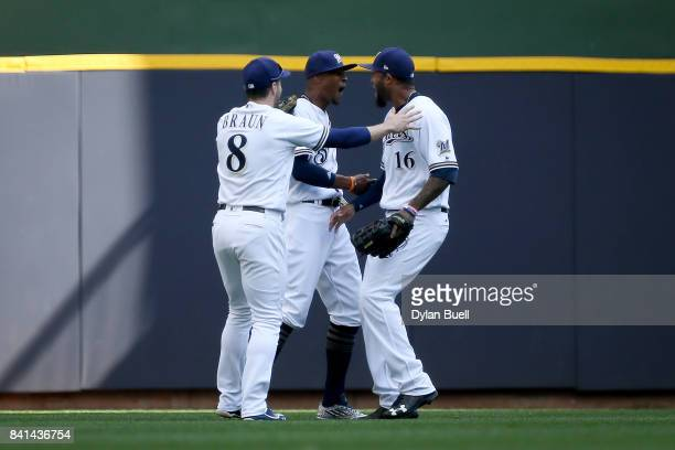 Ryan Braun Keon Broxton and Domingo Santana of the Milwaukee Brewers celebrate after beating the St Louis Cardinals 65 at Miller Park on August 30...