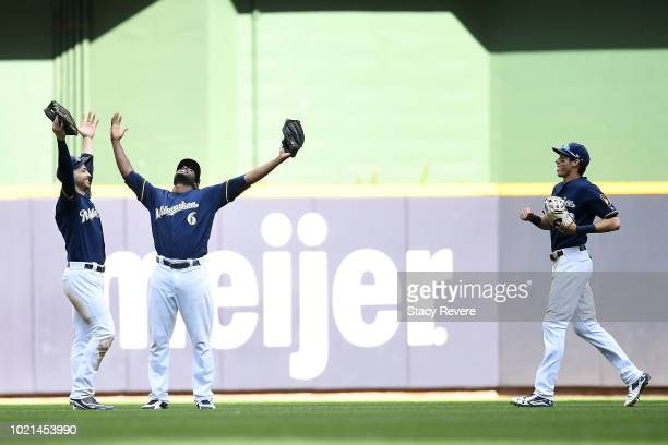 Ryan Braun Lorenzo Cain and Christian Yelich of the Milwaukee Brewers celebrate a victory over the Cincinnati Reds at Miller Park on August 22 2018...