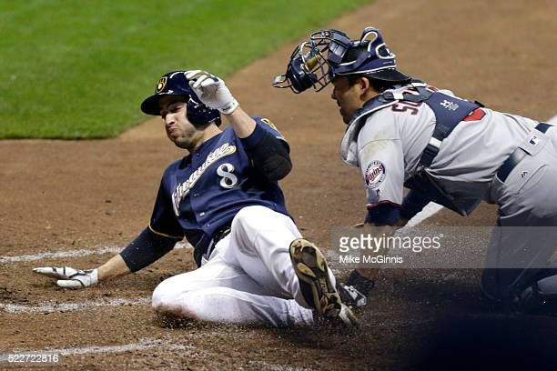 Ryan Braun of the Milwaukee Brewers avoids the tag from Kurt Suzuki of the Minnesota Twins during the fourth inning at Miller Park on April 20, 2016...