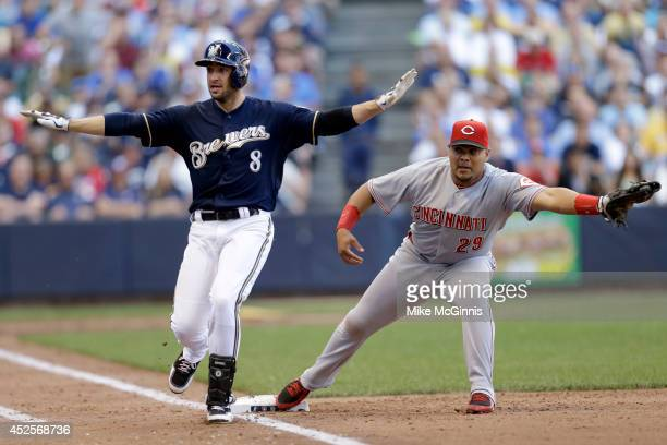 Ryan Braun of the Milwaukee Brewers beats the throw to Brayan Pena at first base for a RBI single in the bottom of the fifth inning against the...