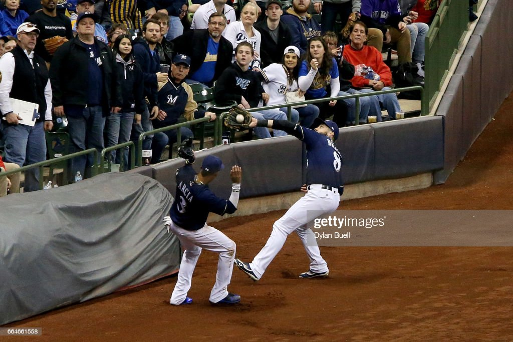 Ryan Braun #8 of the Milwaukee Brewers catches a foul ball as Orlando Arcia #3 looks on in the sixth inning against the Colorado Rockies at Miller Park on April 4, 2017 in Milwaukee, Wisconsin.