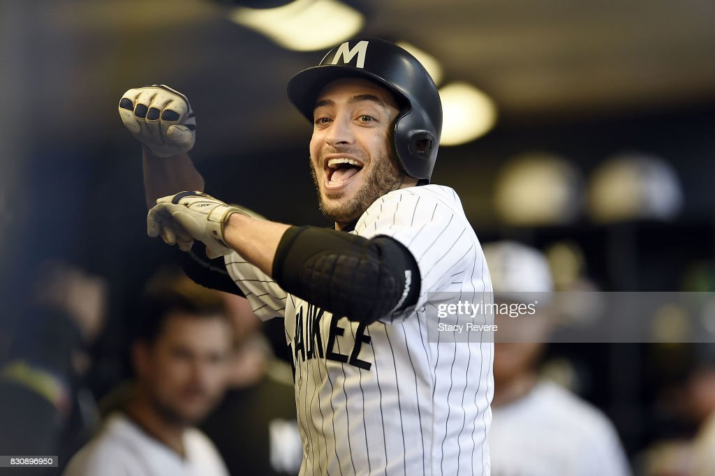 Ryan Braun #8 of the Milwaukee Brewers celebrates a solo home run against the Cincinnati Reds during the fifth inning at Miller Park on August 12, 2017 in Milwaukee, Wisconsin.