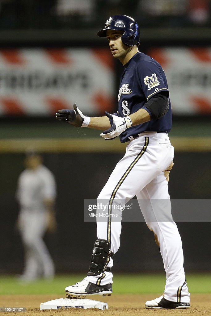 Ryan Braun #8 of the Milwaukee Brewers celebrates after hitting a double, scoring Rickie Weeks in the bottom of the seventh inning against the Colorado Rockies at Miller Park on April 3, 2013 in Milwaukee, Wisconsin.