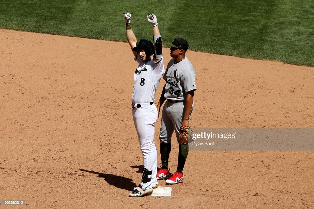Ryan Braun #8 of the Milwaukee Brewers celebrates after hitting a single in the fifth inning as Yairo Munoz #34 of the St. Louis Cardinals looks on at Miller Park on May 28, 2018 in Milwaukee, Wisconsin. MLB players across the league are wearing special uniforms to commemorate Memorial Day.