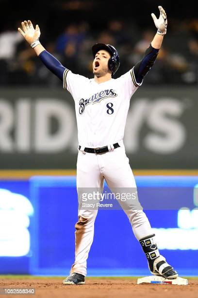 Ryan Braun of the Milwaukee Brewers celebrates after hitting an RBI double to score Christian Yelich against HyunJin Ryu of the Los Angeles Dodgers...