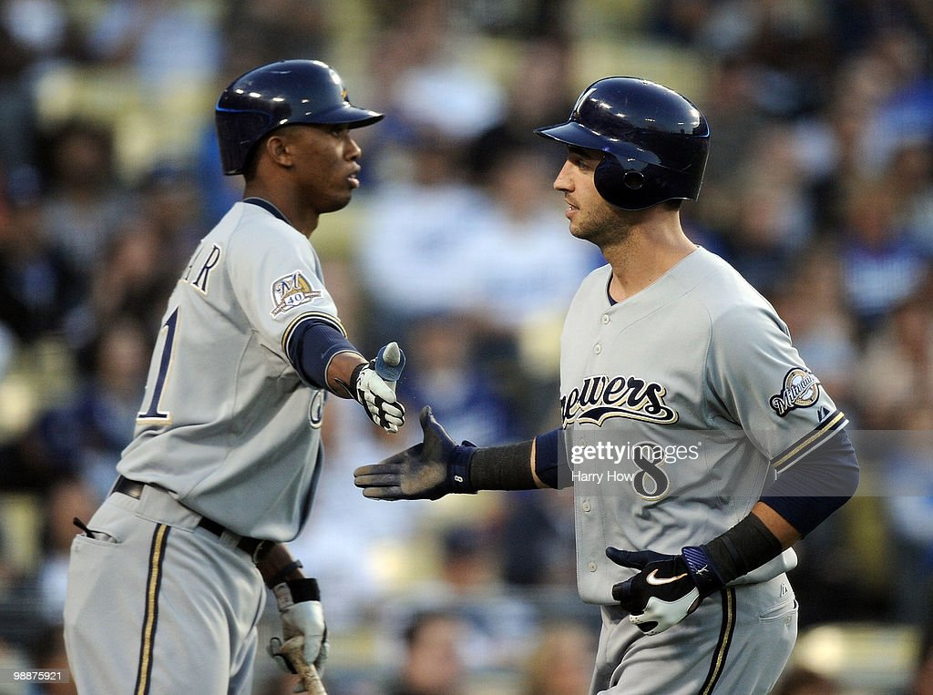 Ryan Braun #8 of the Milwaukee Brewers celebrates his run off a wild pitch with Alcides Escobar #21 against the Los Angeles Dodgers during the first inning at Dodger Stadium on May 5, 2010 in Los Angeles, California.