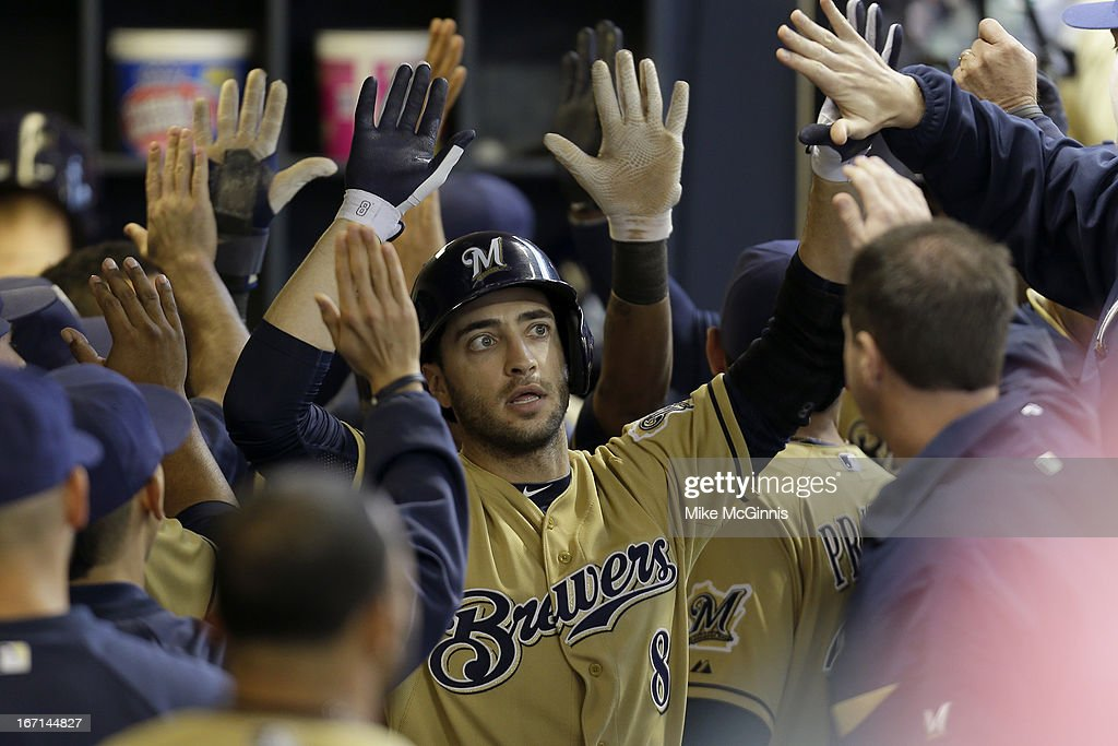Ryan Braun #8 of the Milwaukee Brewers celebrates in the dugout after hitting a three run homer in the bottom of the fifth inning scoring Jean Segura and Yuniesky Betancourt against the Chicago Cubs at Miller Park on April 21, 2013 in Milwaukee, Wisconsin.