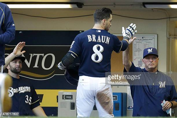 Ryan Braun of the Milwaukee Brewers celebrates in the dugout after reaching on a single off the bat of Adam Lind in the first inning against the New...