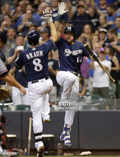 Ryan Braun of the Milwaukee Brewers celebrates with Hernan Perez after hitting a solo home run during the fourth inning against the Atlanta Braves at...