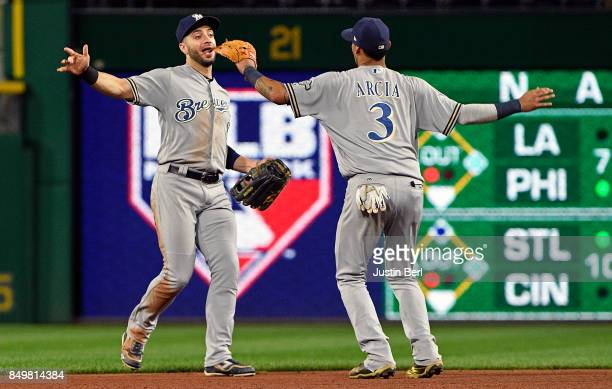 Ryan Braun of the Milwaukee Brewers celebrates with Orlando Arcia after the final out in the Milwaukee Brewers 10 win over the Pittsburgh Pirates at...