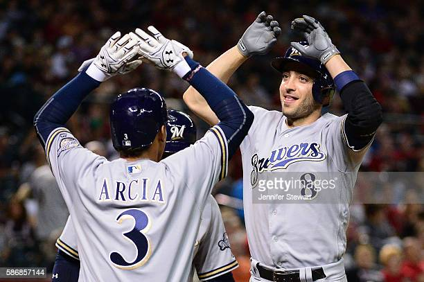 Ryan Braun of the Milwaukee Brewers celebrates with teammate Orlando Arcia after hitting a three run home run during the seventh inning against the...