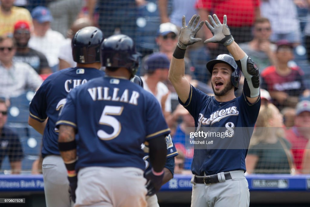 Ryan Braun #8 of the Milwaukee Brewers congratulates Ji-Man Choi #25 after hitting a pinch hit grand slam in the top of the sixth inning against the Philadelphia Phillies at Citizens Bank Park on June 9, 2018 in Philadelphia, Pennsylvania. The Brewers defeated the Phillies 12-3.