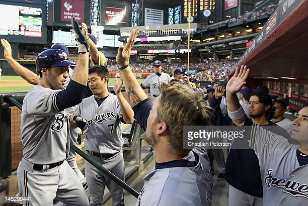 Ryan Braun of the Milwaukee Brewers highfives Corey Hart in the dugout after Braun hit a tworun home run against the Arizona Diamondbacks during the...