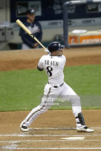 Ryan Braun of the Milwaukee Brewers hits a double in the third inning against the Atlanta Braves at Miller Park on July 07, 2015 in Milwaukee,...