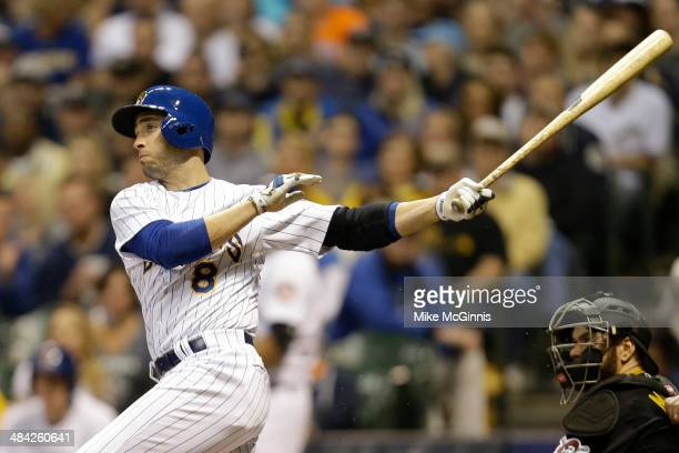 Ryan Braun of the Milwaukee Brewers hits a single in the bottom of the eighth inning against the Pittsburgh Pirates at Miller Park on April 11, 2014...