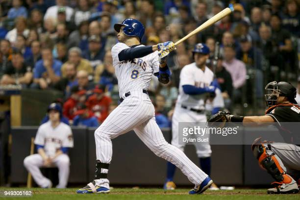 Ryan Braun of the Milwaukee Brewers hits a single in the sixth inning against the Miami Marlins at Miller Park on April 20 2018 in Milwaukee Wisconsin