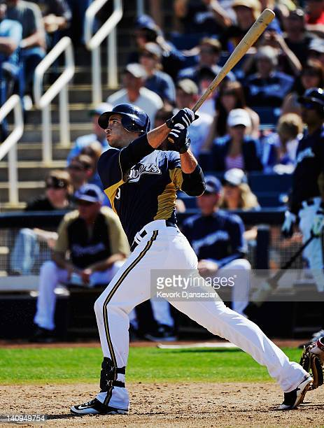 Ryan Braun of the Milwaukee Brewers hits a tworun home run during the third inning of a spring training baseball game against the Cincinnati Reds at...