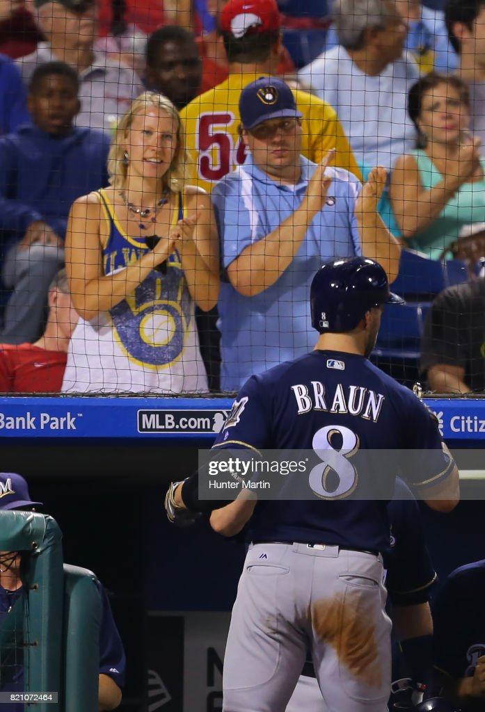 Ryan Braun #8 of the Milwaukee Brewers is applauded by two Brewers fans after scoring a run in the seventh inning during a game against the Philadelphia Phillies at Citizens Bank Park on July 22, 2017 in Philadelphia, Pennsylvania. The Brewers won 9-8.