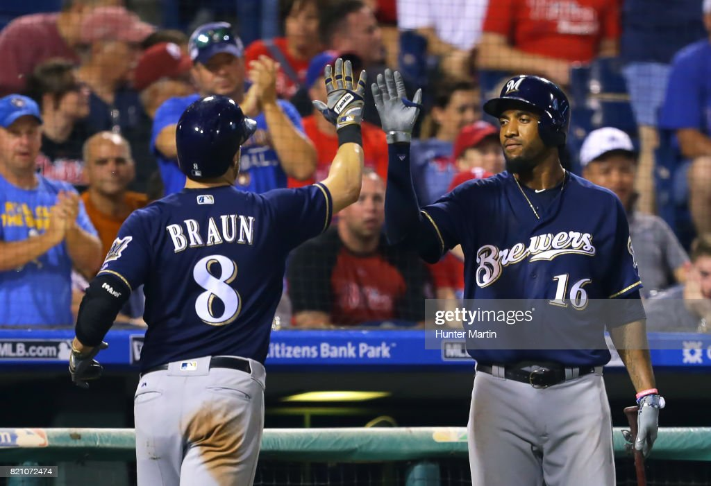 Ryan Braun #8 of the Milwaukee Brewers is congratulated by Domingo Santana #16 after scoring a run in the seventh inning during a game against the Philadelphia Phillies at Citizens Bank Park on July 22, 2017 in Philadelphia, Pennsylvania. The Brewers won 9-8.