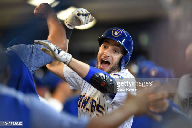 Ryan Braun of the Milwaukee Brewers is congratulated by teammates following a solo home run against the Detroit Tigers during the eighth inning of a...