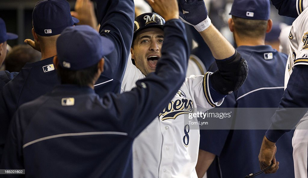 Ryan Braun #8 of the Milwaukee Brewers is greeted by teammates after he scored in the eighth inning against the Colorado Rockies on opening day at Miller Park on April 1, 2013 in Milwaukee, Wisconsin. The Milwaukee Brewers defeated the Colorado Rockier 5-4.