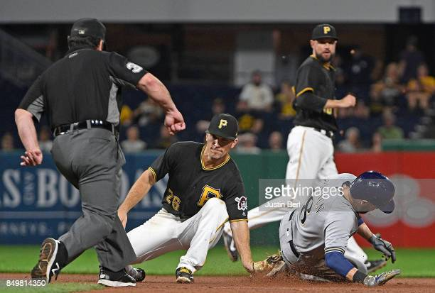 Ryan Braun of the Milwaukee Brewers is tagged out by Adam Frazier of the Pittsburgh Pirates while attempting to steal second base in the sixth inning...