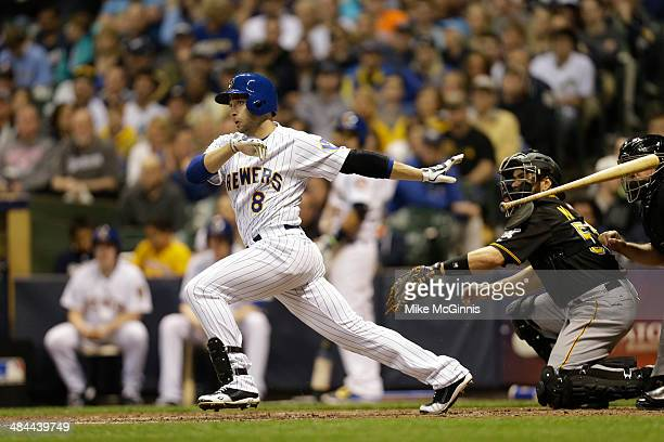 Ryan Braun of the Milwaukee Brewers makes some contact at the plate during the game against the Pittsburgh Pirates at Miller Park on April 11, 2014...