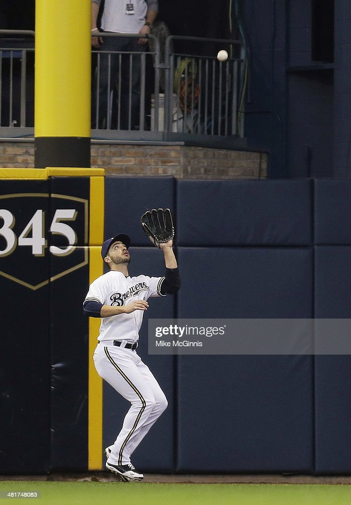 Ryan Braun #8 of the Milwaukee Brewers makes the catch in right field to retire Dan Uggla of the Atlanta Braves in the top of the second inning during Opening Day at Miller Park on March 31, 2014 in Milwaukee, Wisconsin.