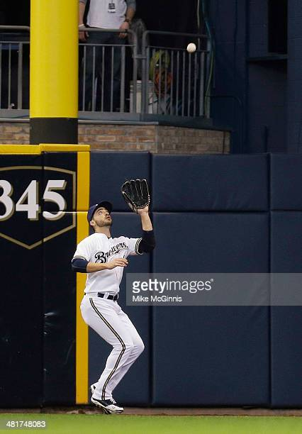 Ryan Braun of the Milwaukee Brewers makes the catch in right field to retire Dan Uggla of the Atlanta Braves in the top of the second inning during...