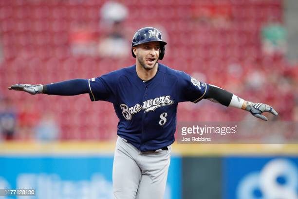 Ryan Braun of the Milwaukee Brewers reacts after hitting a grand slam home run in the first inning against the Cincinnati Reds at Great American Ball...