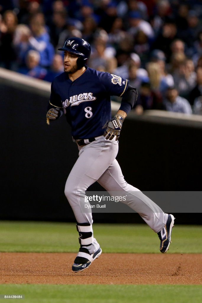 Ryan Braun #8 of the Milwaukee Brewers rounds the bases after hitting his 300th home run in the first inning against the Chicago Cubs at Wrigley Field on September 8, 2017 in Chicago, Illinois.