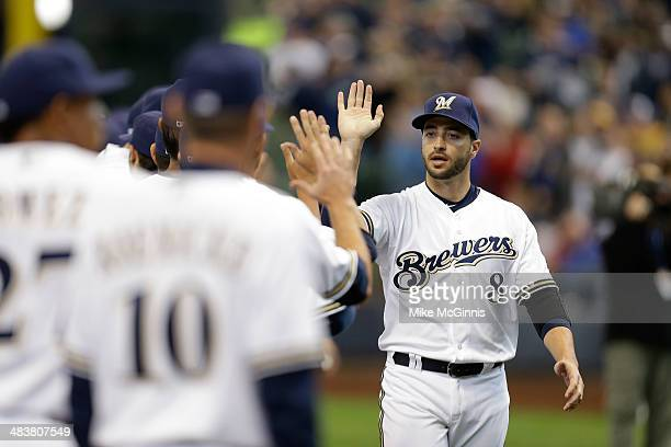 Ryan Braun of the Milwaukee Brewers runs onto the field during the opening announcements before the game against the Atlanta Braves during Opening...