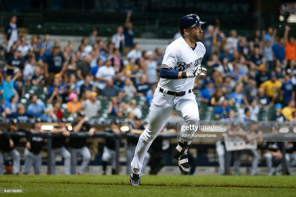 Ryan Braun #8 of the Milwaukee Brewers runs to first after hitting an RBI double to score Domingo Santana #16 (not pictured) during the ninth inning against the Miami Marlins at Miller Park on September 16, 2017 in Milwaukee, Wisconsin. The Marlins defeated the Brewers 7-4.