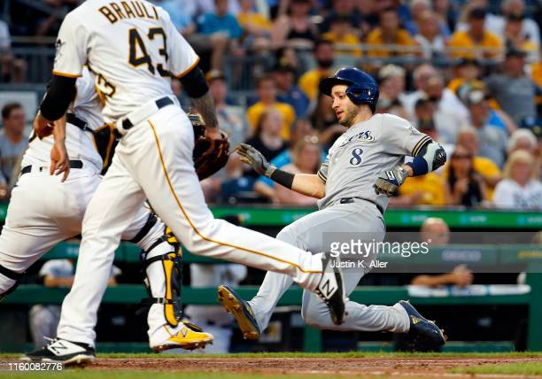 Ryan Braun of the Milwaukee Brewers scores on an RBI double in the fifth inning against the Pittsburgh Pirates at PNC Park on August 6, 2019 in...